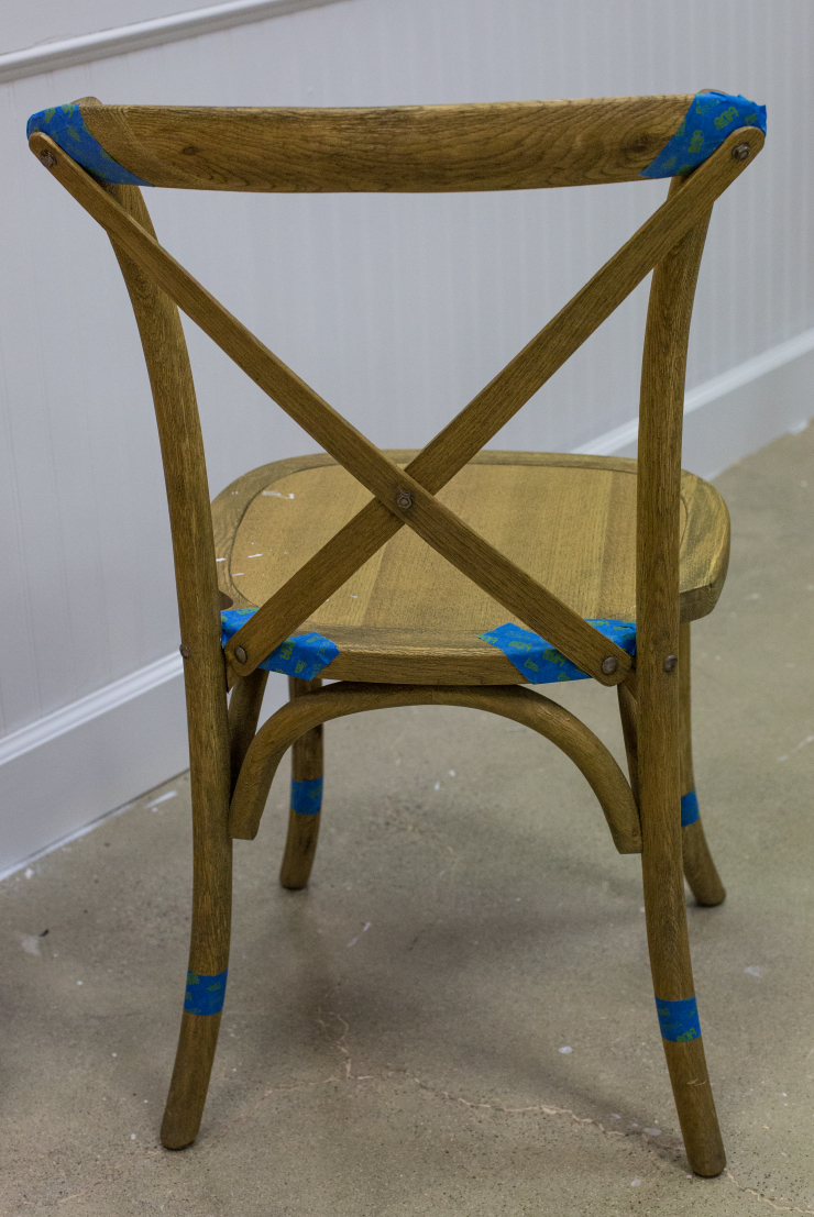 A chair after being prepped with blue tape.