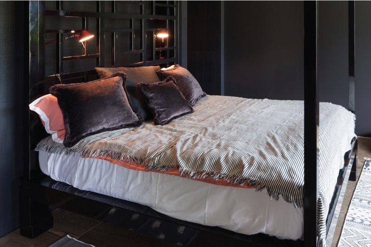 A bedroom painted in a dark gray color.