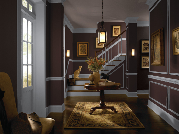 An interior entryway with walls painted in Black Garnet and trim in white.