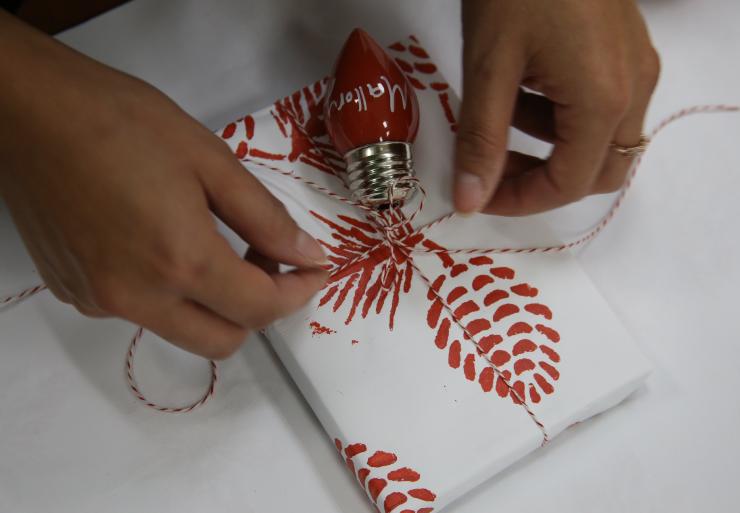 Adding ornament on present.