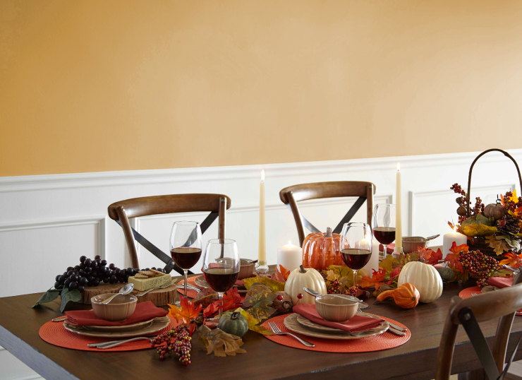 Dining room with table decorated for fall. Color on the wall is Gold Hearted.