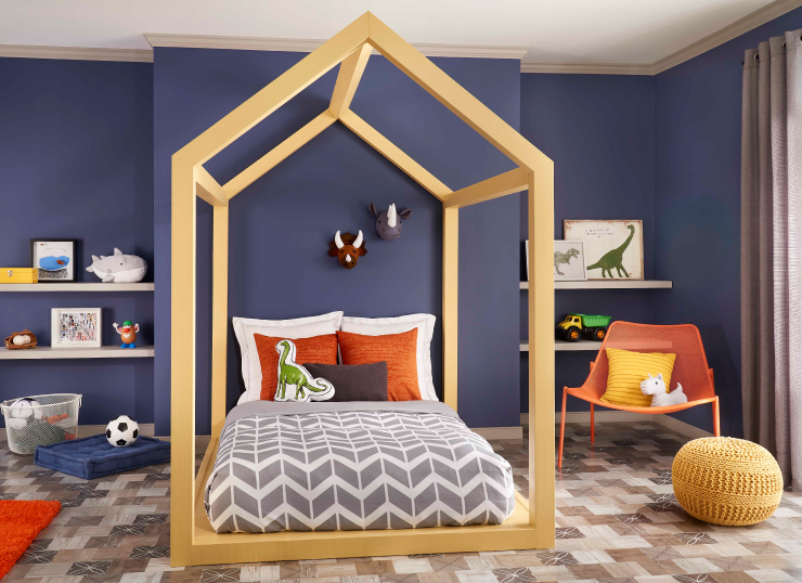 Bedroom with blue painted walls and gold accents. Bedfram is painted in Gold Hearted.