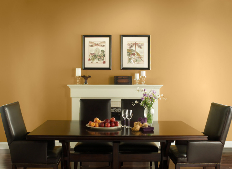 Dining room with walls painted in Gold Hearted.