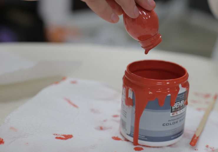 Filling ornament with paint.