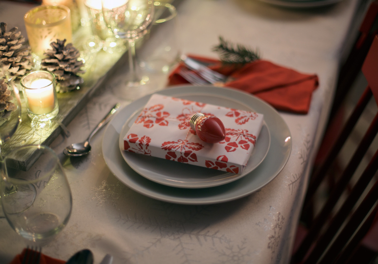 place setting with present on top of plate.