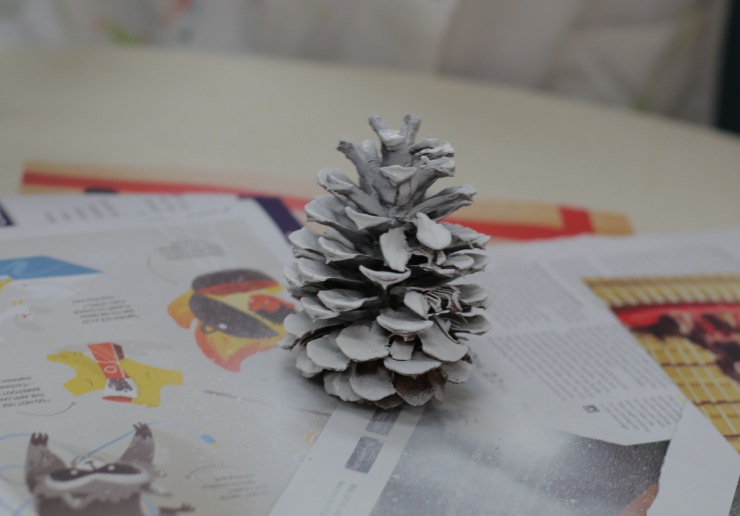 Pinecone with primer on it.