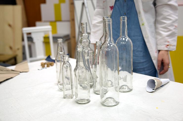 Empty tall glass jars.