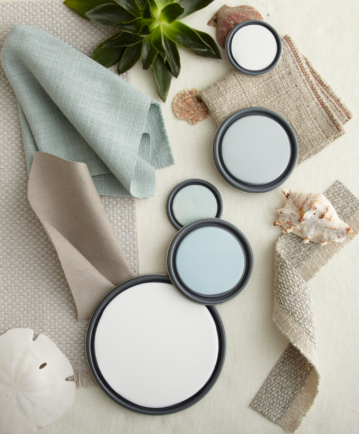 A color palette of whites, beiges and blues created with paint lids and material.