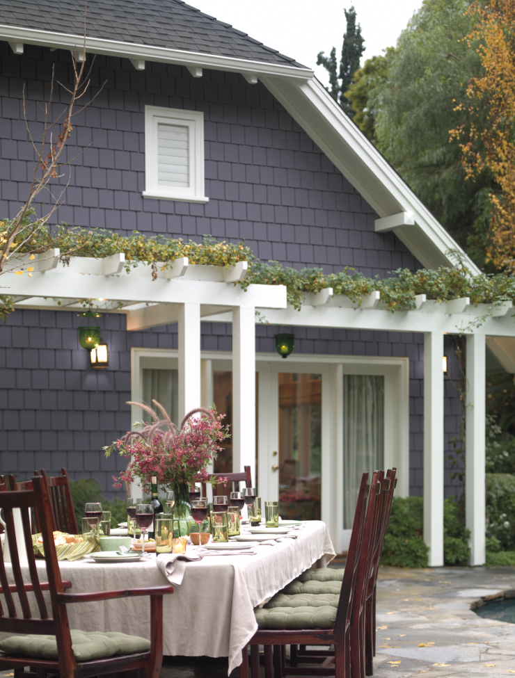 An exterior home, outdoor living area with home painted in Old Amethyst