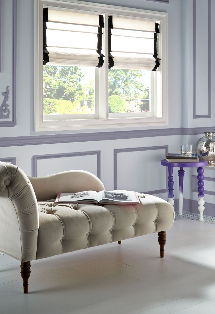 A sitting area, walls trim is painted in Old Amethyst