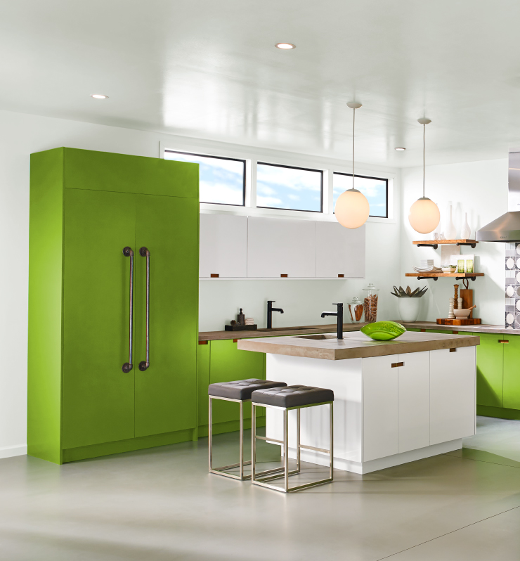 A kitchen with white walls and cabinets painted in Fresh Apple.