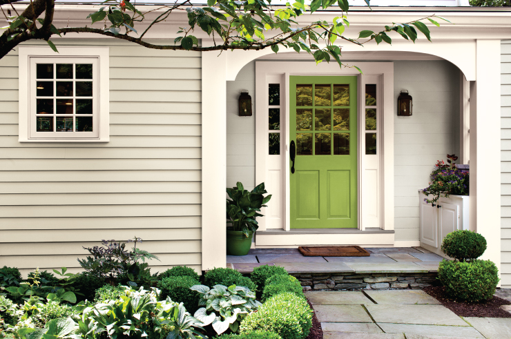 An exterior home entry with front door paint in Fresh Apple.