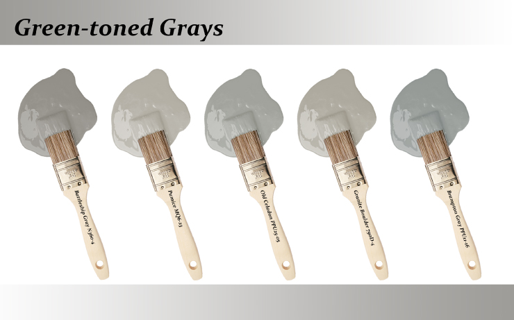 Five paint brushes dipped into paint drops that are Green-toned grays colors.