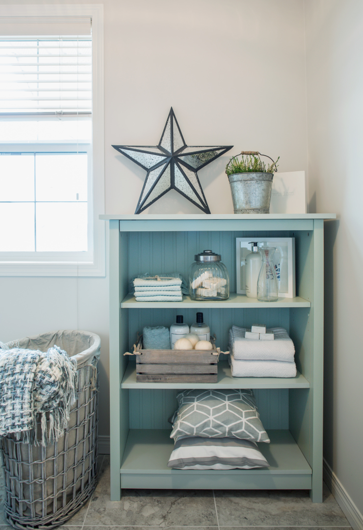 A bathroom cabinet painted in Peek a Blue