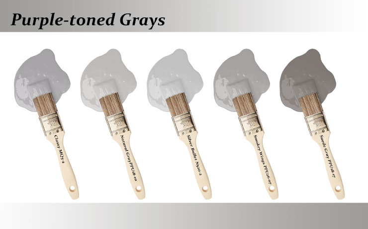 Five paint brushes dipped into paint drops that are Purple-toned grays colors.