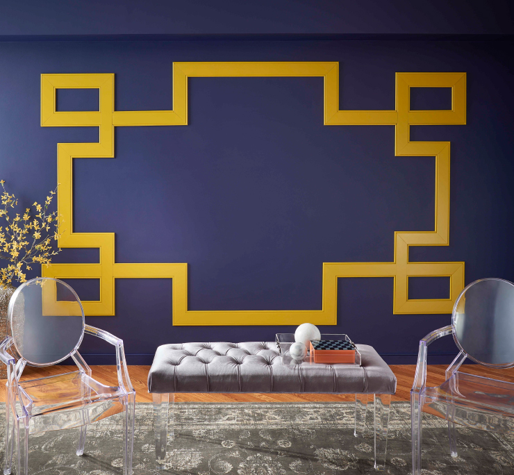 A sitting area with a deep purplish-blue wall and yellow accents on the wall.
