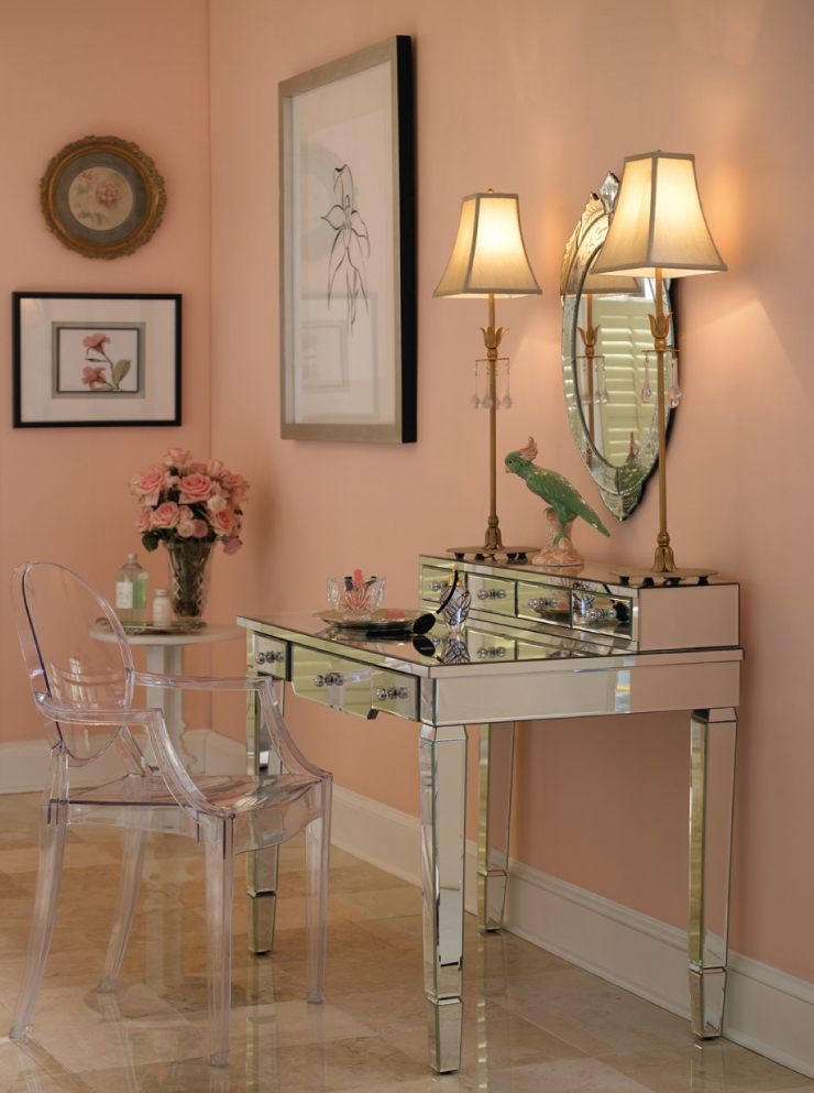 A silver mirrored vanity sitting in front of a wall painted in Flamingo Feather.