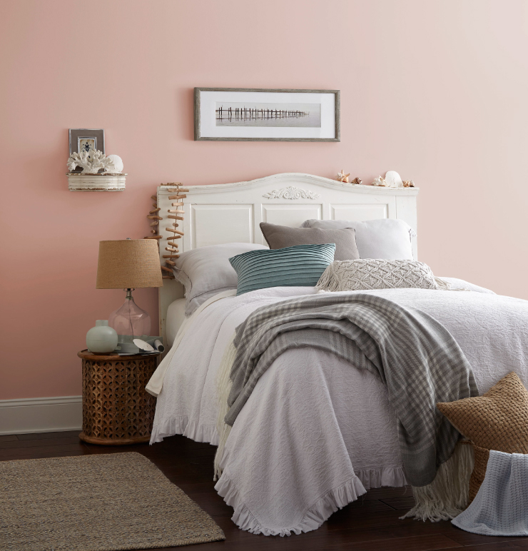 A bedroom with the walls painted in Flamingo Feather.