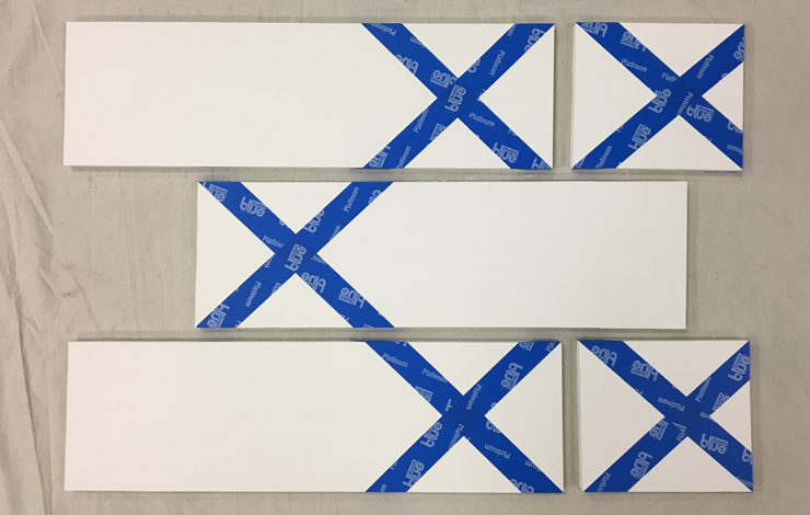 The white boards with painters' tape on them.