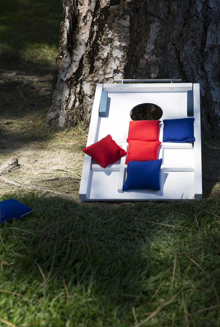 Finished game board placed on a grassy ground set up to play tic tac toe.
