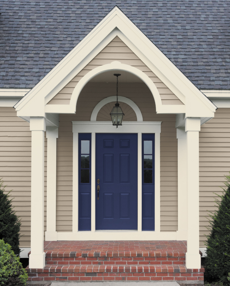 An exterior entry with the front door painted in Bon Nuit