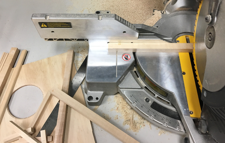 An electric saw with wood pieces being cut.