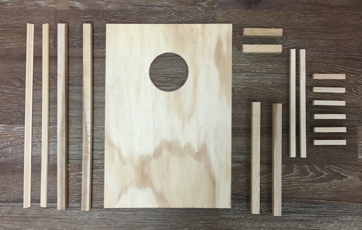 Wood pieces cut to size and shapes needed for the game board.
