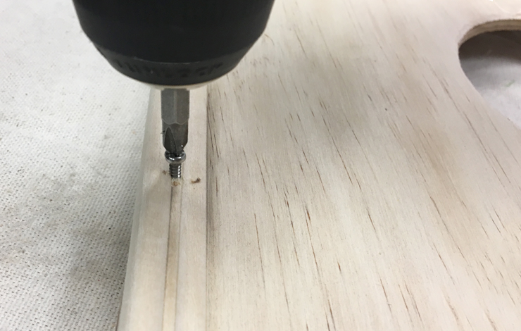 Placing screws into the board and frame