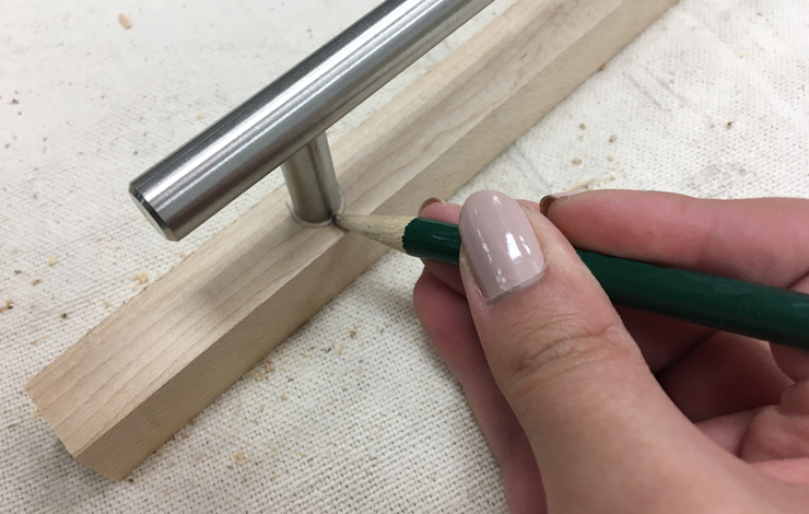 Marking with a pencil spot for handle hole