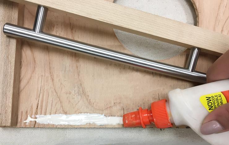 Placing glue on wood.
