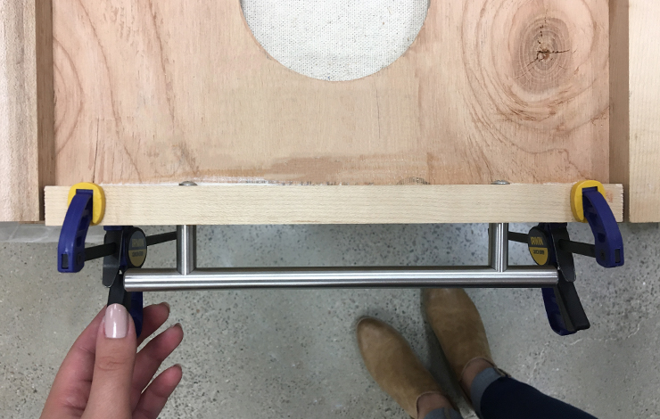 Placing wood on top of the glue and securing with clamps