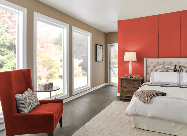 A bedroom with one of the walls painted in Pimento.