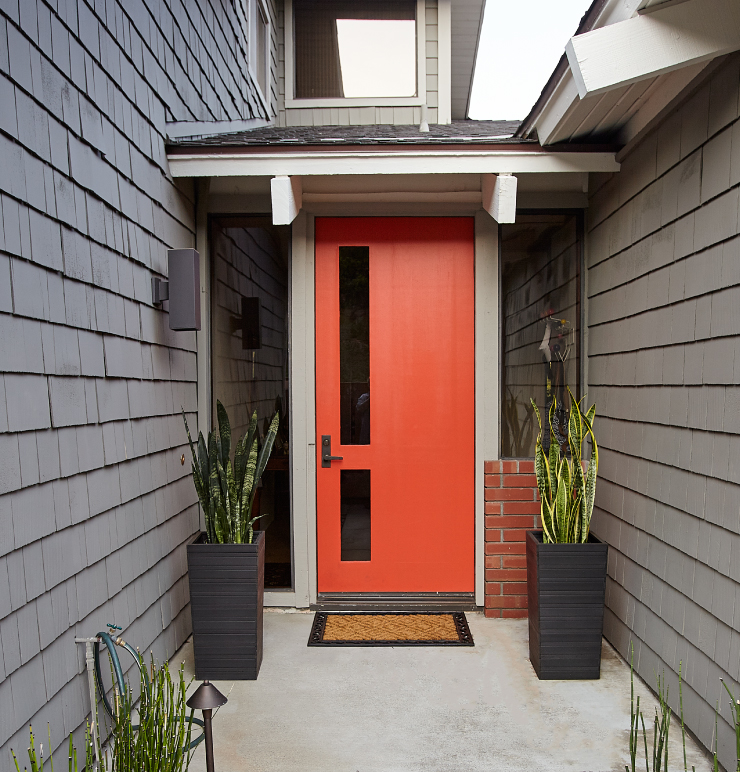 An exterior entry with the door painted in Pimento.