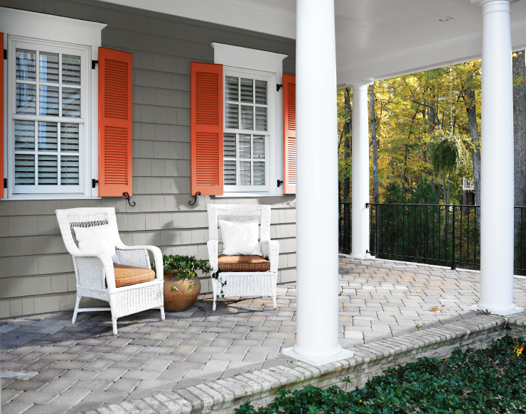 An exterior front patio with the shutters painted in Pimento.
