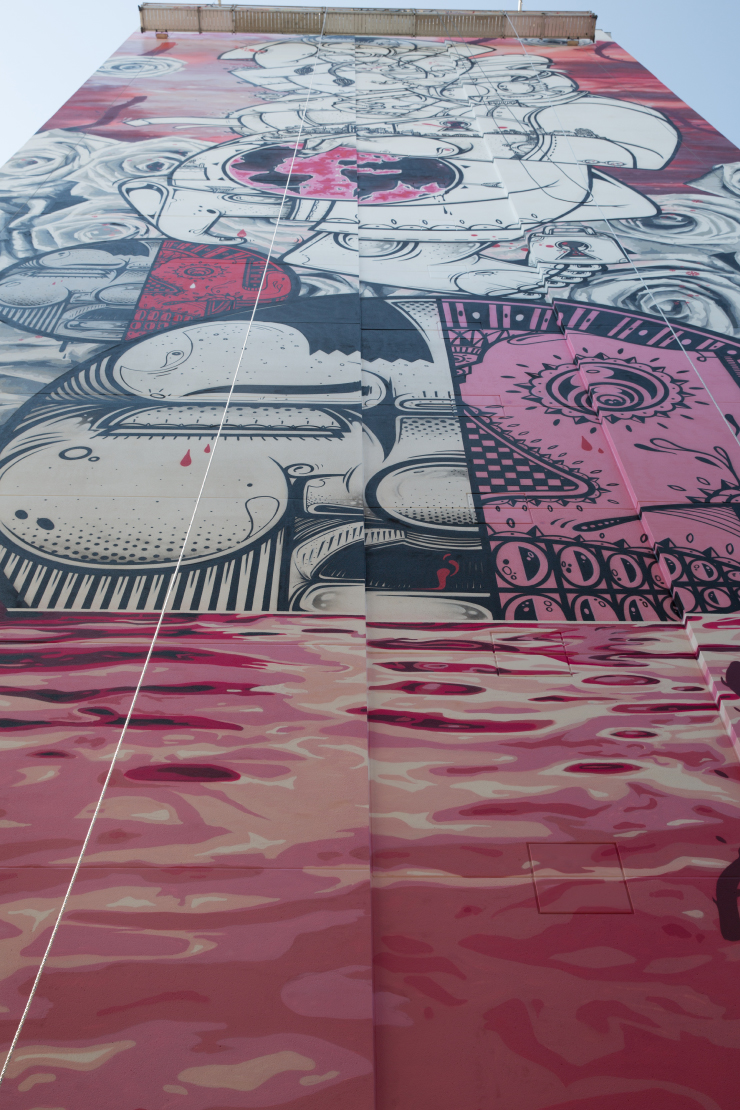 A wall mural painted in white, black and pink colors.