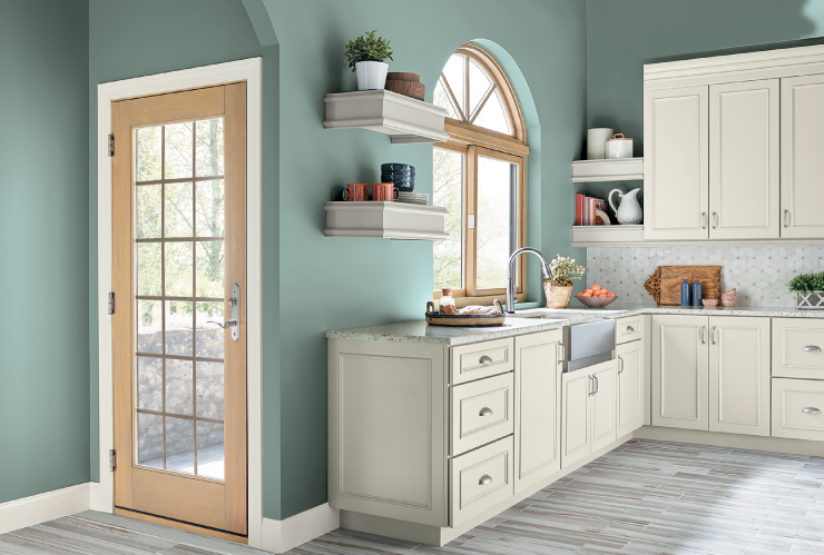 A kitchen with the wall painted in the color: In The Moment.