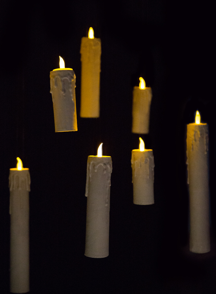 Flameless candles floating against a black background.