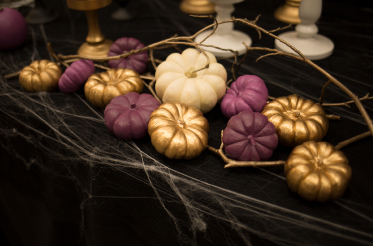 A close up view of the smaller painted pumpkins.