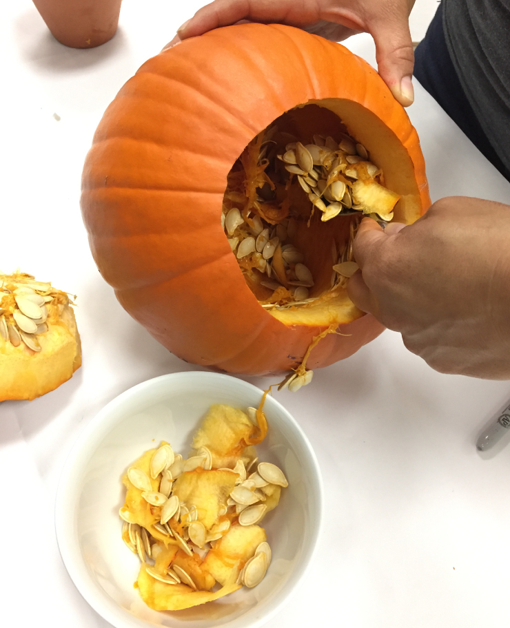 Hollow out your pumpkin with a spoon.