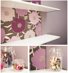 Close up image of the shelves showing the material on the wall and jars filled sewing products.