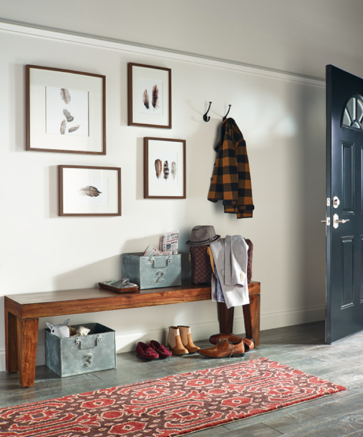 An interior entryway with the wall painted in Soft Focus. The door to the home is painted in a blue color.