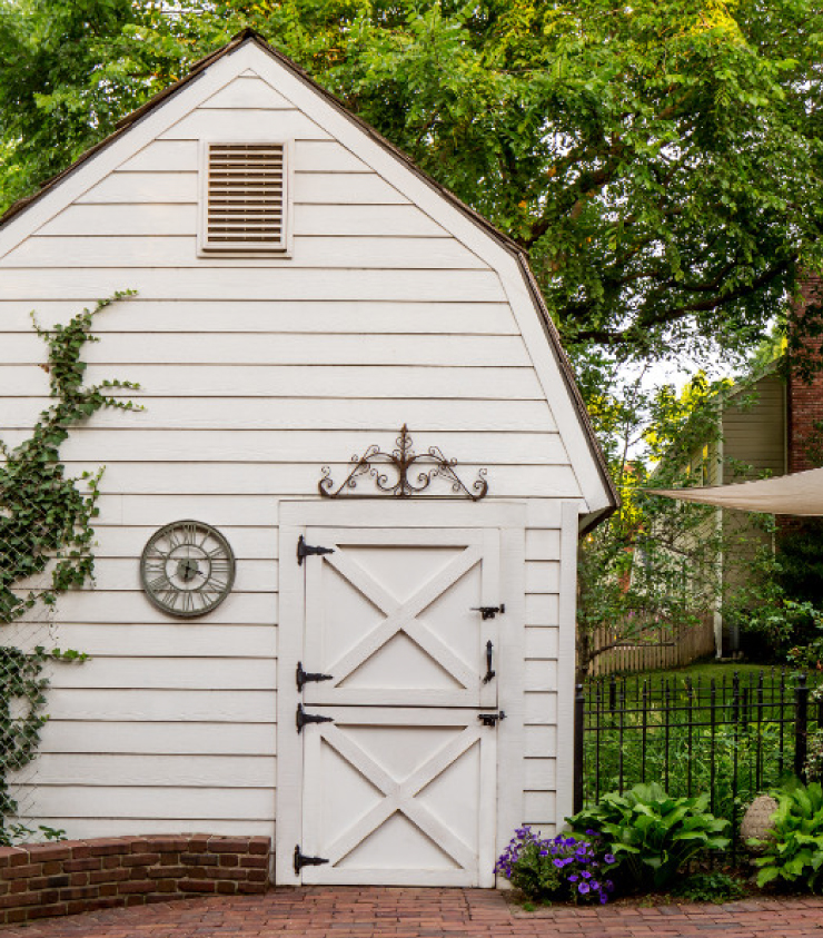 An exterior farmhouse styled shed painted in Soft Focus.