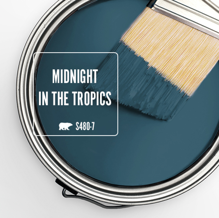 Paint Swatch - Open paint can with paint brush that was dipped showing paint color for Midnight in the Tropics (a deep jewel-toned blue color).