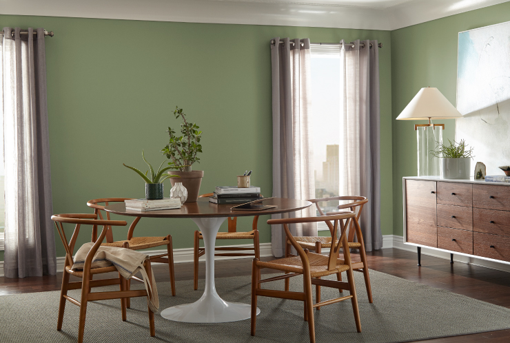 A dining area with walls painted in Nurturing.