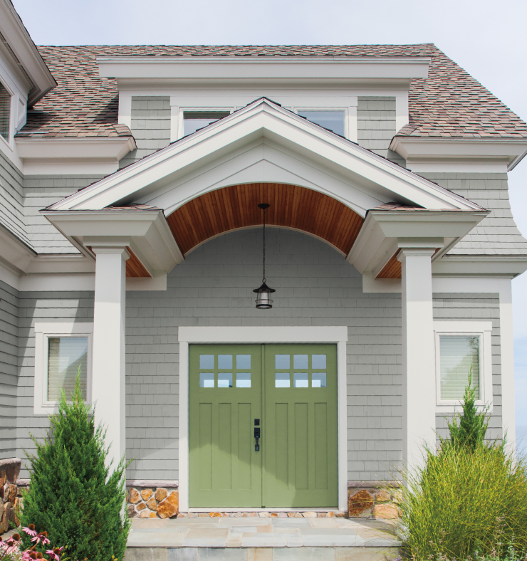 An exterior home painted in a gray color. The door of the home is painted in Nurturing.