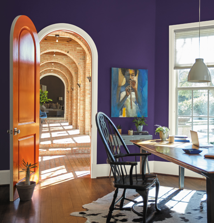 A home office with the walls painted in a bold purple color, King's Court.