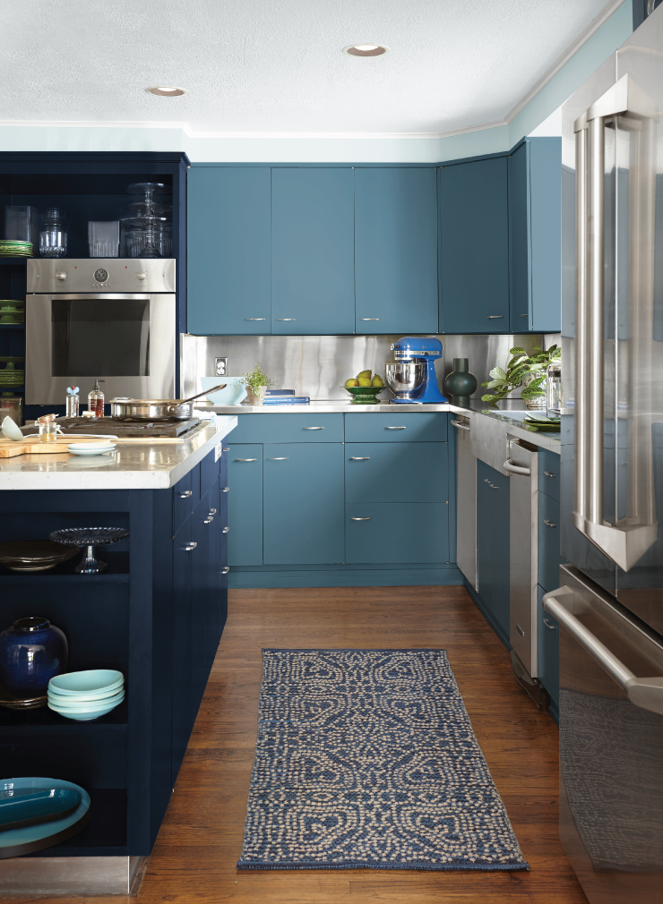 A kitchen with different blues painted for the cabinets.