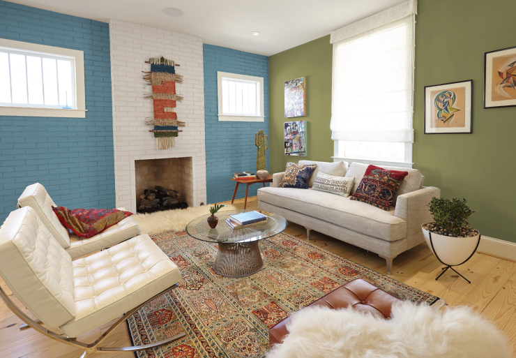 A living room, one wall is green, the other is painted in Blueprint.