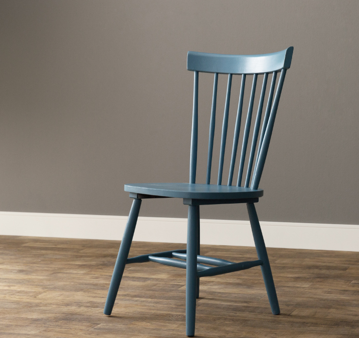 A chair completely repainted with a fresh coat of paint in a blue color called Blueprint.