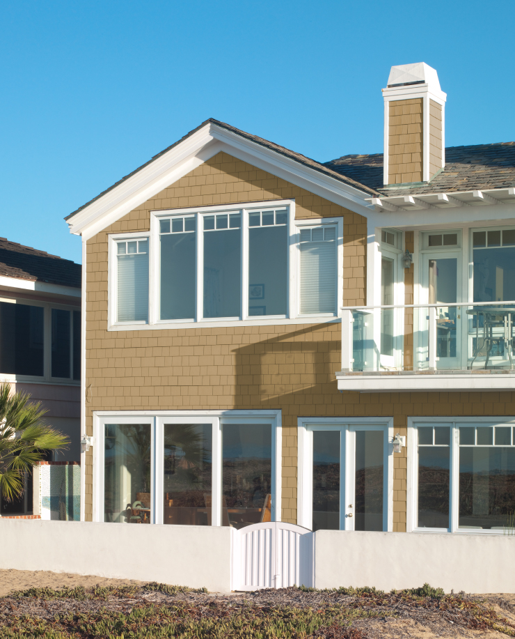 An exterior beach home painted in Amber Autumn.